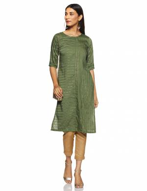 Here Is A Very Pretty And Elegant Looking Kurti In Olive Green Color. Its Fabric Is Soft Towards Skin And Ensures Superb Comfort All Day Long.