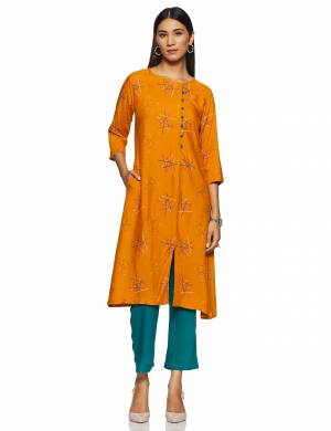 Simple And Elegant Looking Regular Wear Readymade Kurti Is Here In Orange Color Paired With Teal Blue colored bottom. This Kurti Is Light In Weight And Its Fabric Is Durable And Easy To Care For.