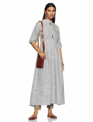 Here Is A Very Pretty And Elegant Looking Kurti In Grey Color Paired With White Colored bottom. Its Fabric Is Soft Towards Skin And Ensures Superb Comfort All Day Long.