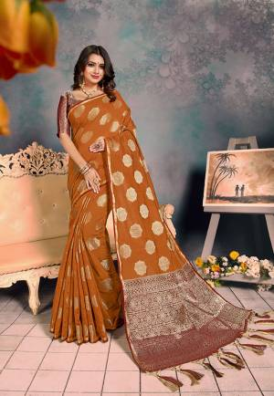 For A Proper Traditional Look, Grab This Pretty Designer Saree In?Brown Color. This Saree Is Chanderi Silk Based Beautified With Detailed Attractive Weave Paired With Art Silk Fabricated Blouse. Buy Now.