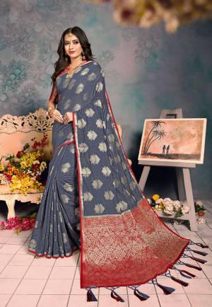 Shine Bright Wearing This Rich Silk Based Designer Saree In?Grey Color. This Saree Is Fabricated On Chanderi Silk Paired With Art Silk Fabricated Blouse. It Is Beautified With Heavy Detailed Weaved Giving An Attractive Look?