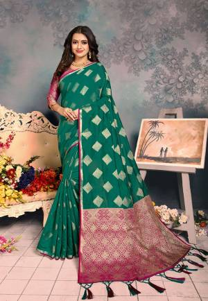 For A Proper Traditional Look, Grab This Pretty Designer Saree In?Sea Green Color. This Saree Is Chanderi Silk Based Beautified With Detailed Attractive Weave Paired With Art Silk Fabricated Blouse. Buy Now.