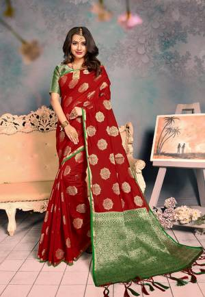 For A Proper Traditional Look, Grab This Pretty Designer Saree In Red Color. This Saree Is Chanderi Silk Based Beautified With Detailed Attractive Weave Paired With Art Silk Fabricated Blouse. Buy Now.