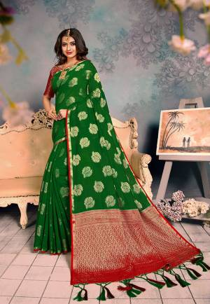 Shine Bright Wearing This Rich Silk Based Designer Saree In?Green Color. This Saree Is Fabricated On Chanderi Silk Paired With Art Silk Fabricated Blouse. It Is Beautified With Heavy Detailed Weaved Giving An Attractive Look?