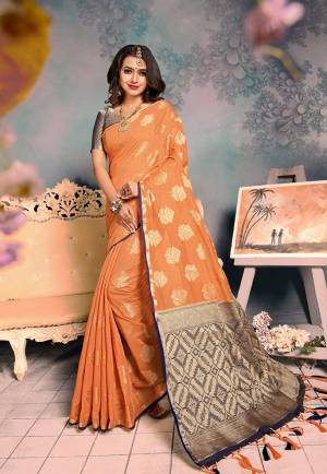 For A Proper Traditional Look, Grab This Pretty Designer Saree In?Orange Color. This Saree Is Chanderi Silk Based Beautified With Detailed Attractive Weave Paired With Art Silk Fabricated Blouse. Buy Now.