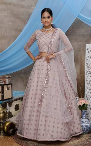 Here Is A Very Pretty Designer Lehenga Choli For The Upcoming Wedding Season In All Over Mauve Color. This Trendy Lehenga Choli Is Fabricated On Net Beautified With Heavy Yet Subtle Tone To Tone Embroidery. Buy This Lovely Piece Now.