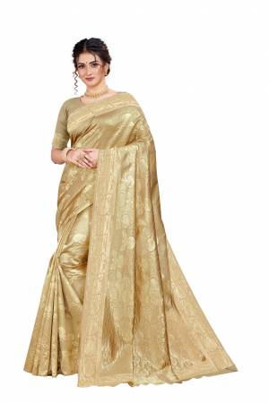 Celebrate This Festive Season With Beauty And Comfort Wearing This Designer Silk Based Saree In Cream Color. This Saree And Blouse Are Fabricated on Art Silk Beautified With Heavy Weave.