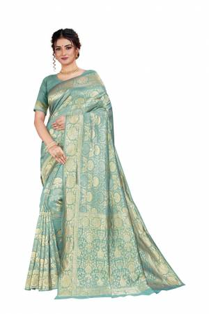 Here Is An Attractive Looking Heavy Weaved Designer Saree In Dusty Blue Color. This Saree and Blouse Are Fabricated On Art Silk Beautified With Detailed Weave. Buy Now.