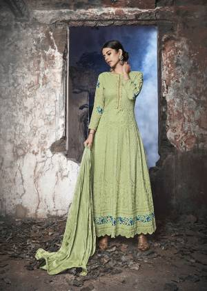 Grab This Heavy Designer Floor Length Suit Is In Attractive Pastel Green Color. Its Heavy Embroidered Top Is Fabricated On Georgette Paired With Santoon Bottom And Chiffon Fabricated Dupatta. Buy This Lovely Lakhnavi Embroidered Floor Length Suit Now.
