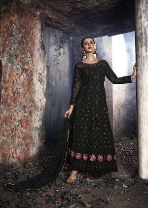 Grab This Heavy Designer Floor Length Suit Is In Attractive Black Color. Its Heavy Embroidered Top Is Fabricated On Georgette Paired With Santoon Bottom And Chiffon Fabricated Dupatta. Buy This Lovely Lakhnavi Embroidered Floor Length Suit Now.