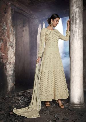 Grab This Heavy Designer Floor Length Suit Is In Attractive Cream Color. Its Heavy Embroidered Top Is Fabricated On Georgette Paired With Santoon Bottom And Chiffon Fabricated Dupatta. Buy This Lovely Lakhnavi Embroidered Floor Length Suit Now.