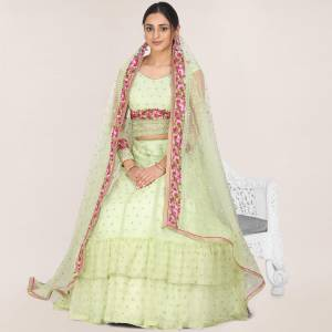 Get Ready For the Upcoming Wedding Season Wearing This Heavy Designer Lehenga Choli In Pastel Green Color. Its Blouse, Lehenga And Dupatta Are Fabricated On Net Beautified With Heavy Embroidery Work.