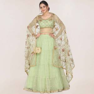 You will Definitely Earn Lots Of Compliments In This Trendy Heavy Designer Lehenga Choli In Pastel Green Fabricated On Net. Its Pretty Color Pallete And Grace Of Fabric Will Give An Elegant Look To Your Personality.