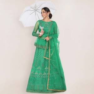 Add This Very Beautiful Heavy Designer Lehenga Choli To Your Wardrobe In Sea Green color. This Pretty Lehenga, Choli And Dupatta Are Net Based Beautified With Embroidery.