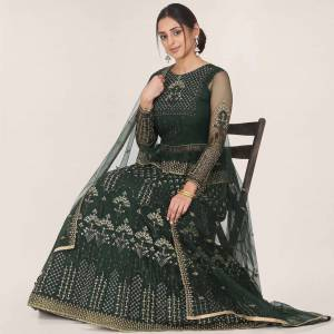 Get Ready For the Upcoming Wedding Season Wearing This Heavy Designer Lehenga Choli In Pine Green Color. Its Blouse, Lehenga And Dupatta Are Fabricated On Net Beautified With Heavy Embroidery Work.