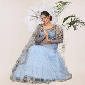 Add This Very Beautiful Heavy Designer Lehenga Choli To Your Wardrobe In Sky Blue color. This Pretty Lehenga, Choli And Dupatta Are Net Based Beautified With Embroidery.