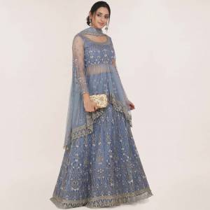 Get Ready For the Upcoming Wedding Season Wearing This Heavy Designer Lehenga Choli In Steel Blue Color. Its Blouse, Lehenga And Dupatta Are Fabricated On Net Beautified With Heavy Embroidery Work.