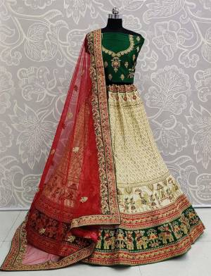 For A Proper Traditional Look, Grab This Heavy Designer Colorful Lehenga Choli In Green Colored Blouse Paired With Cream Colored Lehenga And Red Colored Dupatta. Its Heavy Embroidered Blouse And Lehenga Are Fabricated On Satin Paired With Net Fabricated Embroidered Dupatta.