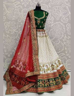 For A Proper Traditional Look, Grab This Heavy Designer Colorful Lehenga Choli In Green Colored Blouse Paired With White Colored Lehenga And Red Colored Dupatta. Its Heavy Embroidered Blouse And Lehenga Are Fabricated On Satin Paired With Net Fabricated Embroidered Dupatta.