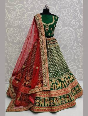 For A Proper Traditional Look, Grab This Heavy Designer Colorful Lehenga Choli In Green Colored Blouse Paired With Green Colored Lehenga And Red Colored Dupatta. Its Heavy Embroidered Blouse And Lehenga Are Fabricated On Satin Paired With Net Fabricated Embroidered Dupatta.