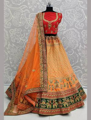 For A Proper Traditional Look, Grab This Heavy Designer Colorful Lehenga Choli In Red Colored Blouse Paired With Orange Colored Lehenga And Orange Colored Dupatta. Its Heavy Embroidered Blouse And Lehenga Are Fabricated On Satin Paired With Net Fabricated Embroidered Dupatta.