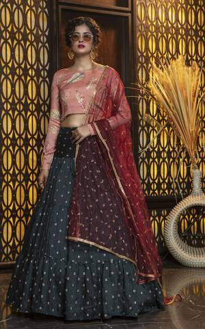 Add This Colorful Designer Lehenga Choli In Peach Colored Blouse Paired With Pine Green Colored Lehenga And Red Colored Dupatta. Its Pretty Blouse Is Rayon Based Paired With Cotton Lehenga And Net Fabricated Dupatta. All Its Fabric Are Light Weight And Ensures Superb Comfort All Day Long.
