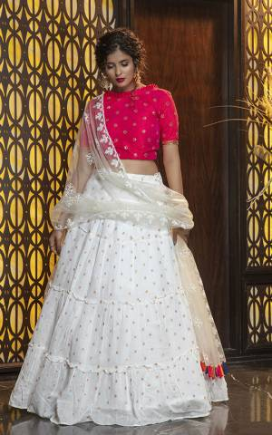 Here Is Lovely and Elegant Looking Designer Lehenga Choli In Rani Pink Colored Blouse Paired With White Colored Lehenga And Dupatta. Its Blouse Is Silk Based Paired With Cotton Fabricated Lehenga And Net Fabricated Dupatta. Buy Now.