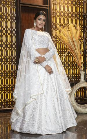 Adorn The Pretty Angelic Look, Wearing This Elegant all Over White Colored Designer Lehenga Choli. This Lehenga Choli Is Cotton Based Paired With Net Fabricated Dupatta. It Is Light In Weight And Easy To Carry All Day Long.