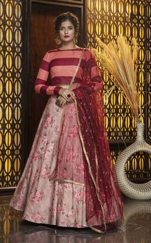 Add This Colorful Designer Lehenga Choli In Maroon And Peach Colored Blouse Paired With Dusty Pink Colored Lehenga And Maroon Colored Dupatta. Its Pretty Blouse Is Cotton Based Paired With Rayon Lehenga And Net Fabricated Dupatta. All Its Fabric Are Light Weight And Ensures Superb Comfort All Day Long.