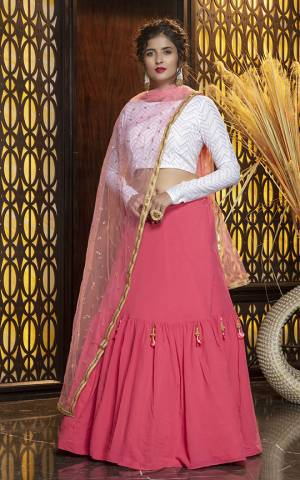 Look Pretty In This Subtle Color Pallete Lehenga Choli In White Colored Blouse Paired With Pink Colored Dupatta. Its Blouse Is Cotton Based Paired With Georgette Fabricated Lehenga And Net Fabricated Dupatta.