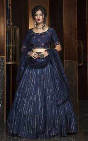 Enhance Your Personality Wearing This Elegant all Over Navy Blue Colored Designer Lehenga Choli. Its Blouse Is Fabricated On Rayon Paired With Cotton Fabricated Lehenga And Net Dupatta. It Is Light In Weight And Easy To Carry All Day Long.