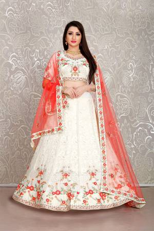 Flaunt Your Rich And Elegant Taste Wearing This Pretty White Colored Lehenga Choli Paired With Red Colored Dupatta. Its Blouse And Lehenga Are Fabricated On Georgette Paired With Net Fabricated Dupatta.