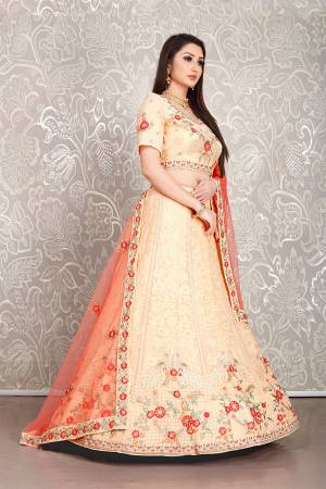 Flaunt Your Rich And Elegant Taste Wearing This Pretty Peach Colored Lehenga Choli Paired With Orange Colored Dupatta. Its Blouse And Lehenga Are Fabricated On Georgette Paired With Net Fabricated Dupatta.