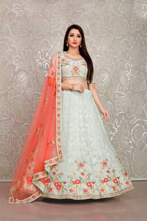 Flaunt Your Rich And Elegant Taste Wearing This Pretty Baby Blue Colored Lehenga Choli Paired With Orange Colored Dupatta. Its Blouse And Lehenga Are Fabricated On Georgette Paired With Net Fabricated Dupatta.