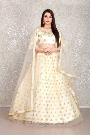 Simple And Elegant Looking Designer Lehenga Choli Is Here In All Over Cream Color. This Lehenga Choli IS Net Based Beautified With Pretty Attractive Embroidered Buttis.