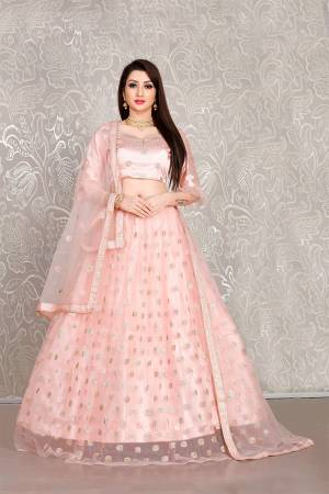 Simple And Elegant Looking Designer Lehenga Choli Is Here In All Over Baby Pink Color. This Lehenga Choli IS Net Based Beautified With Pretty Attractive Embroidered Buttis.
