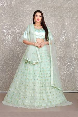 Simple And Elegant Looking Designer Lehenga Choli Is Here In All Over Baby Blue Color. This Lehenga Choli IS Net Based Beautified With Pretty Attractive Embroidered Buttis.