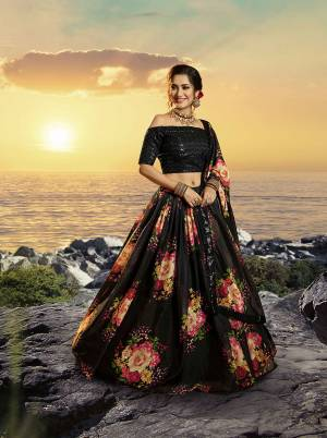 Celebrate This Festive And Wedding Season Wearing This Trendy Designer Lehenga Choli In Sequence Embroidered Black Colored Blouse Paired With Black Colored Lehenga And Dupatta Which Is Beautified With Pretty Floral Prints.