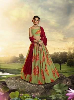You Will Definitely Earn Lots Of Compliments Wearing This Designer Printed Lehenga Choli In Green Color Paired With Red Colored Dupatta. This Lehenga Choli Is Orgenza Based Paired With Georgette Fabricated Sequence Embroidered Dupatta.