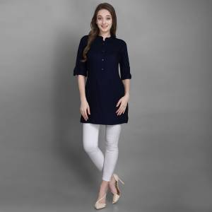 Here Is A Simple And Elegant Looking Readymade Short Kurti For Your Casual Wear In Navy Blue Color. This Plain Kurti Is Fabricated On Rayon , Available In All Regular Sizes. It Can Be Paired With Pants, Leggings Or Denim.