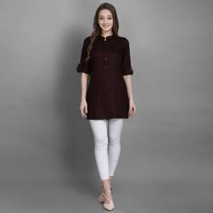 Here Is A Simple And Elegant Looking Readymade Short Kurti For Your Casual Wear In Brown Color. This Plain Kurti Is Fabricated On Rayon , Available In All Regular Sizes. It Can Be Paired With Pants, Leggings Or Denim.