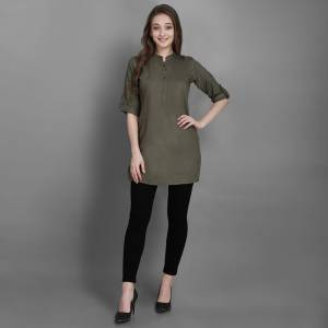Here Is A Simple And Elegant Looking Readymade Short Kurti For Your Casual Wear In Olive Green Color. This Plain Kurti Is Fabricated On Rayon , Available In All Regular Sizes. It Can Be Paired With Pants, Leggings Or Denim.