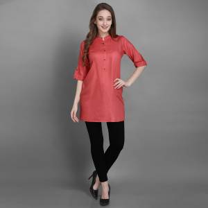 Here Is A Simple And Elegant Looking Readymade Short Kurti For Your Casual Wear In Pink Color. This Plain Kurti Is Fabricated On Rayon , Available In All Regular Sizes. It Can Be Paired With Pants, Leggings Or Denim.