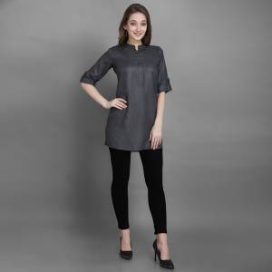 Here Is A Simple And Elegant Looking Readymade Short Kurti For Your Casual Wear In Grey Color. This Plain Kurti Is Fabricated On Rayon , Available In All Regular Sizes. It Can Be Paired With Pants, Leggings Or Denim.