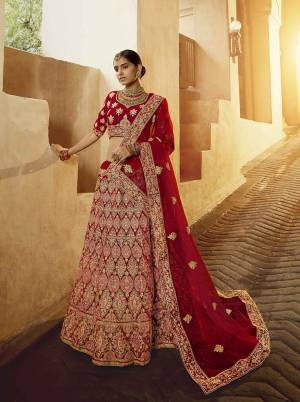 Get Ready For Your D-Day With This Heavy Designer Lehenga Choli In All Over Red Color. This Heavy Embroidered Lehenga Choli Is Fabricated On Velvet Paired With Net Fabricated Dupatta. It Is Beautified With Heavy Coding Jari Embroidery. Buy This Bridal Lehenga Now.