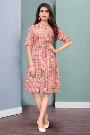 Here Is A Pretty Checks Printed Readymade Kurti Fabricated On Rayon. This Kurti Has Lovely Tunic Pattern Which Is Comfortable And Easy To Carry All Day Long.