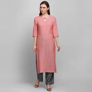 Grab This Simple And Elegant Readymade Pair Of Kurti and Plazzo In Pink And Dark Grey Color. This Pretty Pair Is Fabricated On Rayon Beautified With Lining Prints. It Is Light In Weight And Easy To Carry All Day Long.