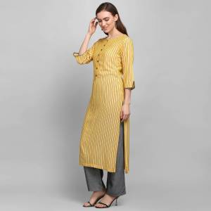For Your Casual Or Semi-Casual Wear, Grab This Simple And Elegant Looking Readymade Pair Of Kurti and Plazzo In Yellow And Dark Grey. This Pair Is Rayon Based Which Is Soft Towards Skin And Ensures Superb Comfort All Day Long.