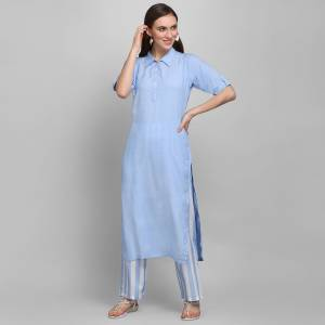 Grab This Simple And Elegant Readymade Pair Of Kurti and Plazzo In Blue and White Color. This Pretty Pair Is Fabricated On Rayon Beautified With Lining Prints. It Is Light In Weight And Easy To Carry All Day Long.