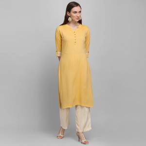 For Your Casual Or Semi-Casual Wear, Grab This Simple And Elegant Looking Readymade Pair Of Kurti and Plazzo In Yellow And Grey. This Pair Is Rayon Based Which Is Soft Towards Skin And Ensures Superb Comfort All Day Long.